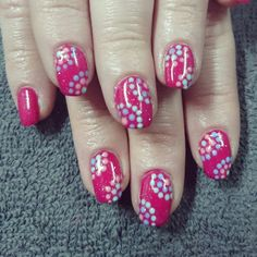 Pink nails with dot pattern