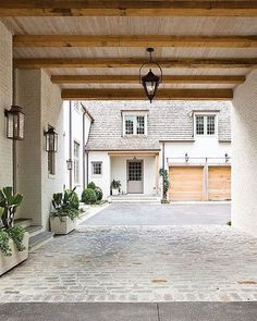 This porte cochere by #peterblockarchitects was presented as inspiration in a meeting today and my response was  {design by @bethwebb and photo by @ericageorgedines for @atlantahomesmag}