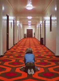 """One of the most talked-about shots in the picture is the eerie tracking sequence which follows Danny as he pedals at high speed through corridor after corridor on his plastic Big Wheel tricycle. The soundtrack explodes with noise when the wheel is on wooden flooring and is abruptly silent as it crosses over carpet. We needed to have the lens just a few inches from the floor and to travel rapidly just behind or ahead of the bike."""