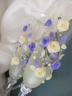 Wedding Toasting Glasses decorated with polymer clay roses, faux pearls and Swarovski crystal beads. $50.00, via Etsy.