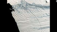 Massive iceberg moving along the ocean towards Antarctica.
