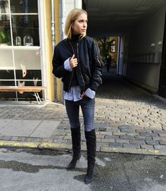 Pernille Teisbaek wears a button-down shirt, bomber jacket, skinny jeans, and over-the-knee boots