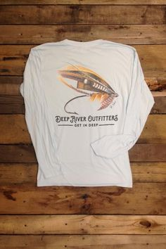 Deep River Outfitters celebrates the sport and art of fly fishing with our Chief Fly Long Sleeve Solar Performance tees, perfect for the river or every day featuring up to 50 UPF solar protection and moisture wicking technologies. Original art by Tyler Daniel is printed on our Artic Blue 100% microfiber polyester long sleeve solar performance tee.