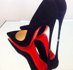 christian louboutin 'so kate 120' on top of a mirror - look at those red soles…