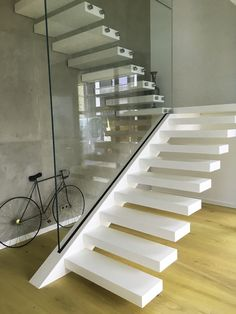 This was a extraordinary project... a cantilevered stair with corian treads. Treads are translucent and LED is inside... find more inspiring modern stairs at http://www.stairs-siller.co.uk/modern-stairs/