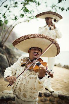 A mariachi band!!! http://www.mirrormirrorincbridal.com/#