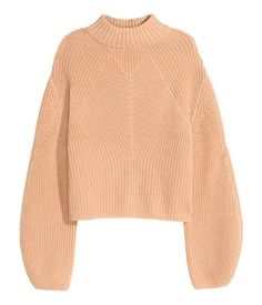 Rib-knit sweater in a cotton blend with dropped shoulders, wide balloon sleeves, and wide ribbing at neckline.