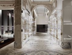 Gorgeous bookmatched flooring in Antonia boutique, Milan by Vincenzo De Cotiis