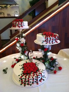Separate tier wedding cake with classic icing red roses