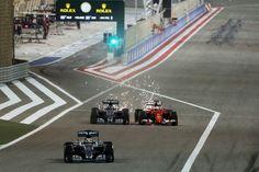 Vettel vs Rosberg as Hamilton exits the pits, 2015 Bahrain GP, Sakhir