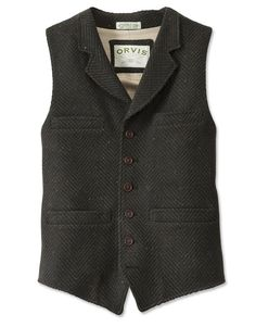"""Back in the days of the American frontier, you'd be hard pressed to find a cowboy who didn't own (or aspire to own) a men's tweed vest of this caliber. As desirable and functional today as it ever was, this tweed vest, cut in a classic """"down-the-center"""" style, features a six-button front with four pockets, two adjustable side tabs, and a left-side interior pocket. In dark olive. Pure wool tweed. Dry clean. Made in USA.  <br />Sizes: M(38-40), L(42-44), XL(46-48), XXL(50-52)."""