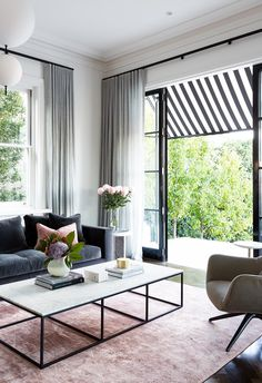 Modern living room with steel frame doors opening to garden. Modern Victorian, Victorian Terrace, Home And Living, Home And Family, Modern Living, Steel Frame Doors, Living Room Wall Units, Living Rooms, House Inside