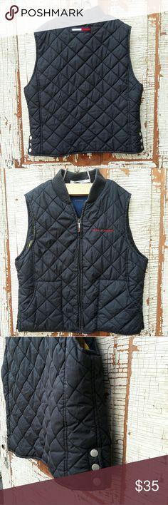 """Tommy Hilfiger black puffer vest large Zippered black Tommy Hilfiger puffer vest with yellow plaid inside.  Shoulders-14.5"""" Bust-20"""" Length- 21"""" Tommy Hilfiger Jackets & Coats Vests"""