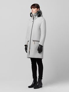 Halstrøm is our unisex snow parka, designed for transitional and deep winter wear through modularity and performative materials. A breathable, ponte-bonded shell provides wind and waterproof protection; while its removable hood, Italian Toscana fur, and thermal-insulated quilted body liner provide modular wear options for deep winter, coldweather wear.
