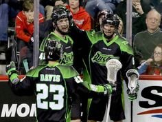 Saskatchewan Rush players Jarrett Davis, Dan Taylor and Zak Greer celebrate their overtime win against the Calgary Roughnecks in NLL action at the Scotiabank Saddledome in Calgary on Sunday. Calgary, Champs, Scores, Motorcycle Jacket, Dan, Sunday, Action, Celebrities, Domingo