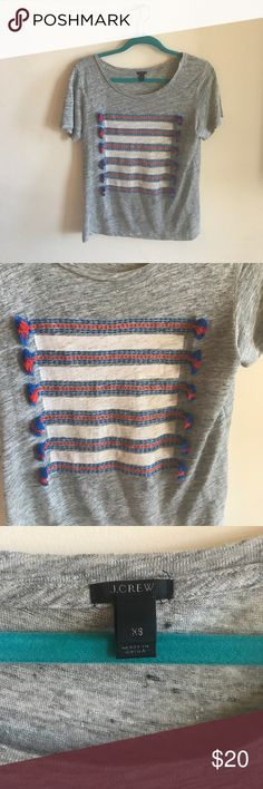 Like New J.crew linen tassle top XS Relaxed fit . 100% linen red and blue tassle top on a gray shirt. Worn once . Beautiful condition and comfortable classic shirt. Runs big. J. Crew Tops