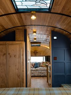 Completely love the stained glass skylights and the wood & paint design. Also those brass bulkhead lights are gorgeous and I want some, lol. Airstream Camping, Airstream Living, Airstream Remodel, Airstream Renovation, Airstream Interior, Vintage Airstream, Airstream Trailers, Trailer Remodel, Vintage Travel Trailers