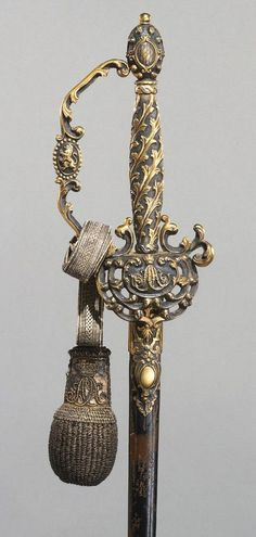 Parade Sword with Scabbard  Maker: hilt made by Johann Stroblberger, German (active Munich) Dated: circa 1825 Culture: German Place of Origin: made in Munich, Germany Medium: steel, engraved and gilded; cast brass, steel gilded with silver; leather