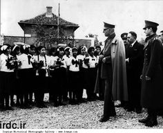Reza Shah and his son Mohammadreza visit school children after fifting veil