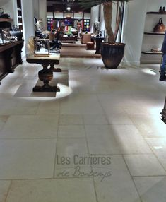The interior of the Rodeo Drive flagship is classical with limestone and oak flooring, wood shelving and a feature wrought iron staircase linking the two floors.!#french #stoneflooring #anticstone #design  #frenchstone #castle #french #limestone #beige