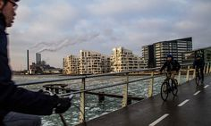 Cyclists cross a bridge from Islands Brygge in Copenhagen with the Oersted gas fired power station in the distance Fire Powers, Gas Fires, Copenhagen Denmark, Environmental Issues, Urban Planning, Oil And Gas, The Guardian, Ecology, New York Skyline