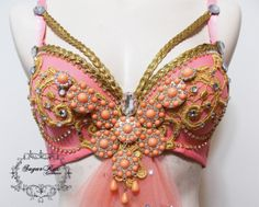 Hey, I found this really awesome Etsy listing at http://www.etsy.com/listing/150318205/peach-and-gold-rave-bra-custom-event