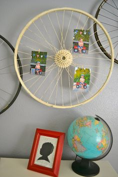 bicycle wheel art picture display- this gives me an idea for how to display student work, could hang from ceiling for a circular display or on the wall for a vertical display...