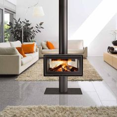 Modern pellet stove the middle living room area with gray tile floor and white…
