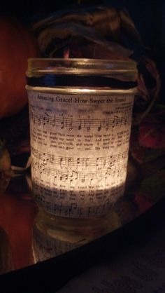 Mason jar turned amazing candle... used a quilted mason jar and mod-podged the lyrics to amazing grace on the outside, wrapped top with raffia and let the light shine :)