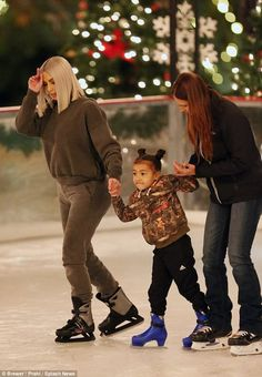 Follow the leader: Kardashian held her daughter's hand as they made their way on the ice