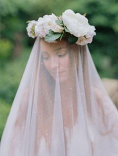 Veil Inspiration: Gorgeous flower crown and ethereal veil. Photo by Laura Murray Photography via Wedding Sparrow.