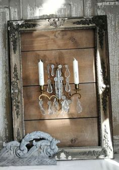 Sconce on wood, in pretty frame