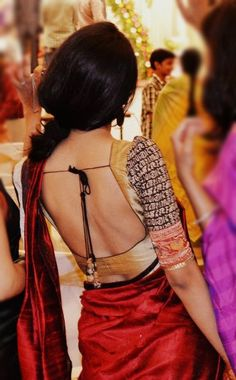 Contrasting saree blouse, in printed black and gold. With a dangerously low back! :) :)