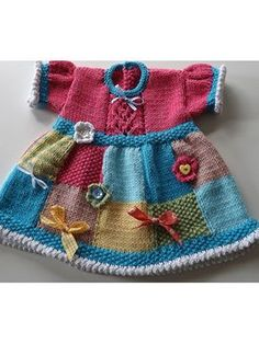 Patchwork Judy Baby Dress pattern download from e-PatternsCentral.com -- A pretty patchwork dress to adorn your little one! This pattern was designed as a way to use up oddments of pretty yarns and is decorated with odd buttons, bows and ribbons left over from other projects.