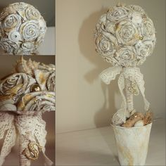 Serra Topiary. Used materials: fiber garden pot, lace, linen roses, twine, wine corks, pebbles, Height 33 cm.