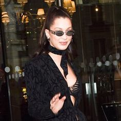 Bella Hadid flashes her bra as she leaves the Royal Monceau hotel in Paris