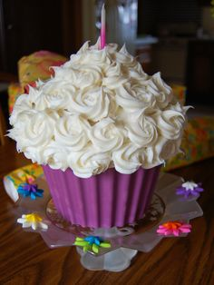 Giant Cupcake Cake - This was my first time baking a cake using the Wilton's giant cupcake pan. I used lavender colored candy melts to make a mold of the bottom of the cupcake for the liner.
