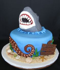 Jaws - The shark head is RKT - first time for me. I need to work on getting it smoother, but I see the possibilities. The 'sand' is crushed vanilla wafers held in place (sort of) with buttercream. I got a lot of the undersea life ideas from CC. Shark Birthday Cakes, 8th Birthday Cake, Birthday Ideas, Happy Birthday, Shark Cake, Nautical Cake, Sea Cakes, Cake Images, Cakes For Boys