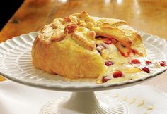 This pastry-wrapped soft cheese,topped with cranberries, apricots and almonds, is great for the holidays but it's so good, you'll want to serve it year-round.