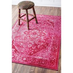 This area rug by nuLOOM adds beautiful style and functionality to any room. This overdyed rug is made from a nylon-blend fiber and is available in multiple effervescent colors and patterns. The vintag