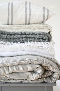 Linens in shades of grey create a Scandinavian look which suits this time of year and will make any bedroom look appealing.