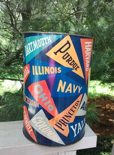 Check out this item in my Etsy shop https://www.etsy.com/listing/384763608/metal-college-pennants-round-trash-can