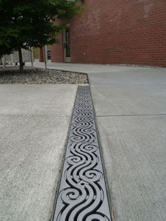 Decorative driveway drainage trench drain grate for from Iron Age Designs Landscape Design, Garden Design, Patio Design, Yard Drainage, Landscape Drainage, Drainage Grates, Gutter Drainage, Trench Drain, Drainage Solutions