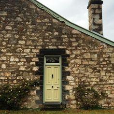 Climbing rose with matching door. Gorgeous stone cottage in Port Fairy #doors #doortraits #doorlove #doorsworldwide #greatoceanroad #portfairy by sweetdoors