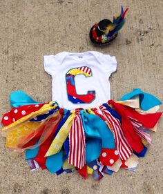 Circus birthday outfit Red Yellow Blue and Turquoise. Love the skirt