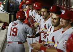 St. Louis Cardinals Jon Jay (19) celebrates his home run hit against the Arizona Diamondbacks in the seventh inning during an MLB baseball game Tuesday, April 2, 2013, in Phoenix. (AP Photo/Ross D. Franklin)