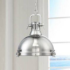Brighten a country-style farmhouse kitchen with this industrial pendant light bathed in a stunning chrome finish.