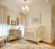 LOVE the mirrored dresser/changing table, crystal chandelier, and cream/tope color scheme. I think this with pops of pale pink would be perfect.