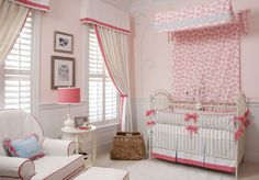 Not a fan of all the pink, but I love the window treatments and canopy over the crib...