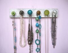 Necklace Holder to replace ceramic hand. Crown molding + crystal, porcelain, and painted knobs. Check out Pier One Imports for super cute knobs.
